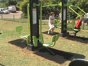 Grass Mat Playground Flooring around Gym Equipment