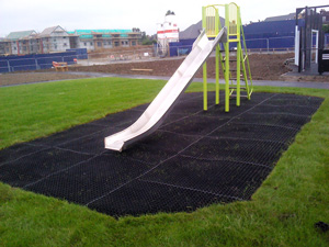 Grass Mat Soft Play Surfacing under a Slide